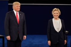 Republican presidential nominee Donald Trump stands next to Democratic presidential nominee Hillary Clinton during the second presidential debate at Washington University in St. Louis, Sunday, Oct. 9, 2016. (AP Photo/Julio Cortez)