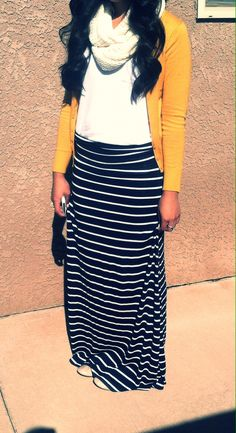 I think I have this exact outfit! Yellow cardigan, cream scarf, white top, black and white striped skirt.