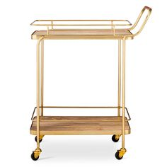 Even if you don't think you need this—you need it. This gorgeous Threshold Metal, Wood and Leather Bar Cart in Gold is pure perfection. Serve your guests in style with this two-tiered cart and when it's not in use, it doubles as the chicest side table you've ever seen. A classic curved handle and four casters make it a breeze to move liquor, wine and glasses.