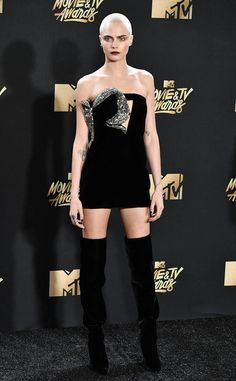 Cara Delevingne from MTV Movie & TV Awards 2017: Red Carpet Arrivals  Bald is beautiful! Just ask the one and only Cara.