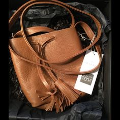 """⭐️ """" HP """" ⭐️R Zoe Box of Style Leather Shaffer Bag 💗 Shaffer LA Leather Bucket Bag ! """" Sidekick !  From Rachel Zoe's Box of Style Beauty ! Bag comes in a gorgeous Caramel Leather ! Softest leather I have ever felt ! Lightweight ! Treat this versatile shade of tan as a neutral and paint it with everything ! From high-contrast whites to vibrant separates ! Strap is about 55 inches in length ! Cross body and bucket bag in one ! The 2 beautiful tassels pull to close ! It's a smaller bag for on…"""