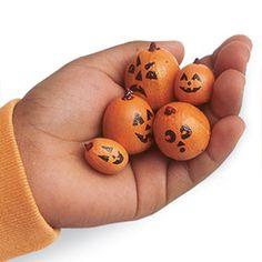 Make teeny jack-o-lanterns out of acorns painted orange
