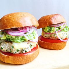 Spicy Chicken Burgers with Guacamole, Cheddar, and Pickled Onions  - Delish.com Use a gluten free bun or go bunless!