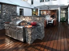 The barbecue courtyard realizes architect Steve Kemp's vision for a small home that lives large. With all doors open, five rooms become one large multipurpose space. - HGTV Green Home Barbecue Courtyard Pictures on HGTV Outdoor Kitchen Plans, Outdoor Kitchen Countertops, Outdoor Kitchen Design, Outdoor Kitchens, Kitchen Cabinets, Backyard Kitchen, Outdoor Rooms, Outdoor Living, Outdoor Decor