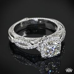 Verragio 4 Prong Cushion Halo Diamond Engagement Ring is set in 18k white gold and holds a 0.712ct A CUT ABOVE® Diamond. - Click image to find more Weddings Pinterest pins