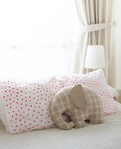 love this elephant pillow for a baby girl's room