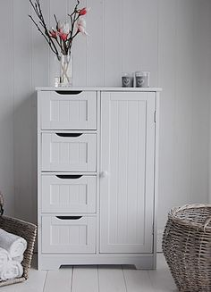white freestanding bathroom cabinet with 4 drawers from the white