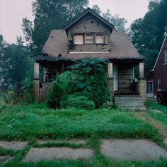 Abandoned home in Detroit. There are over 60,000 of these, just like this one, in D-town right now. Some are for sale for $1.00
