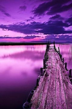 purple sky, water and pier