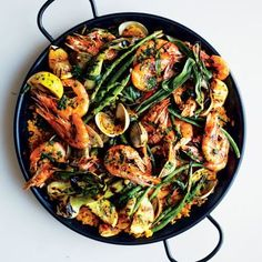 This Seafood Paella takes some effort from organizing to slicing and dice prep work, but once you get cooking the process gets easier. The results are amazingly delicious and well worth the effort!