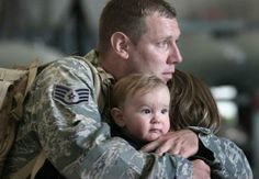 Another very powerful Image. Soldier on Home leave with Partner & Son