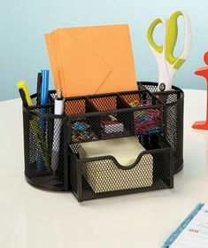 This Mesh Office Supply Organizer keeps your desk's items easily accessible and tidy. Deep compartments on the sides and back provide space for pens, pencils, scissors, and other long items. Three compartments across the top are designed for frequent