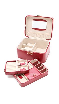 Gift Boutique Jewelry Travel Box | Lizard-embossed patent leather lends a luxe quality to this compact, organized jewelry box. The push-lock closure opens to a plush microfiber interior, outfitted with 2 lift-out trays, one of which can be used as a traveling jewelry case. Additional built-in compartments are perfect for storing favorite pieces, and a cosmetic mirror details the inside of the lid. The box can also be locked with an included key for extra security. Leather: Cowhide. Imported…