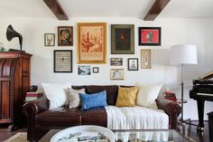 HomePolish: A gallery wall is a flexible, mutable decorative process. Click through our slideshow to see different styles. Which one works best in your space? (Note from me: If you use changeable EasyGallery® frames, it really IS flexible! Eclectic Living Room, Living Spaces, Living Rooms, Spanish Revival Home, Spanish Colonial, Spanish Style, Interior Decorating, Interior Design, Decorating Ideas