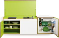 Miniki | Miniki transforms your kitchen into useful open space. Miniki offers three different hand-made birch plywood modules (two 24″ x 24″ x 24″ cubes and a double length option) that can stand alone or combine to house a hidden sink, stovetop, storage space, dishwasher, refrigerator or even an oven. |