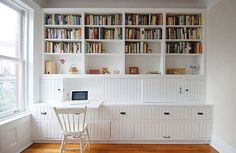 Nellie's built-ins provide storage for books, office supplies, and media equipment.
