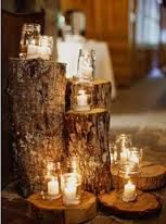 Ceremony backdrop, birch stumps with candles + tall birch poles and twigs in galvanized buckets