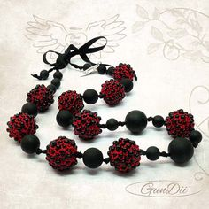 Gundii Pavonia collection red color necklase from Gundii Accessories. Handmade,Materials: iris thread, black pearls @gundii