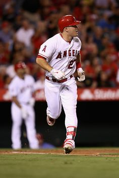 Mike Trout of the Los Angeles Angels of Anaheim watches his solo home run during the fourth inning of a game against the Oakland Athletics at Angel...