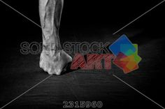 stock photo of male fist standing on the floor