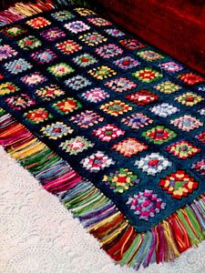 This reminds me of a rug rather than an afghan or blanket, but it's great none the less. This...