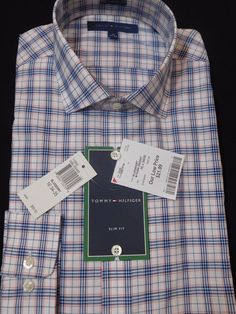 The polished look of this plaid blue, white, and orange dress shirt from Tommy Hilfiger. Slim fit. A slim fit is cut closer through the chest, sleeves and waist. Features slim armholes and sleeves.