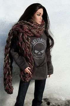 This beautiful doll is modelling a sweatshirt with Harley-Davidson scull motif. This is the same design motif on the chrome pieces on our Harley.