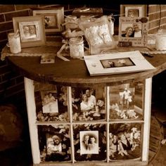 I used a wooden wire reel to create my rustic sign in table. Decorated with photo frames, old window with pics and lace covered mason jars.