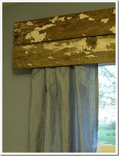 Scrap wood valance. @Christy Jennings this could be added in your room and tie the bed and windows together :)