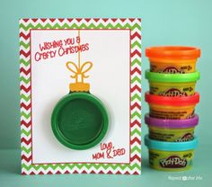 Since my kids are at the age where they are pretty much obsessed with Play-doh, I thought it would be nice to make them little holiday gift that was quick and easy to put together and something I knew my little crafters would enjoy. The little party pack play-doh containers make perfect little Christmas ornaments …