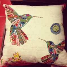Pier 1 Beaded Birds Pillow, wouldnt be hard to redo. Pick a hodge-podge of cute fabric scraps for the birds and flower, and construct them completely before sewing to the pillow. Love