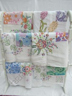 Embroidered linen tablecloth & vintage sheets, recycled into aprons...