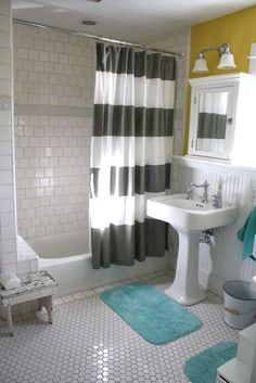 Kids bath... white tile, gray and white stripes, mustard & aqua accents