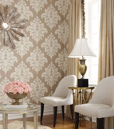 Beautiful wall.  This is wallpaper by Thibaut Filigree - Sydney Damask. A stencil would work as well.