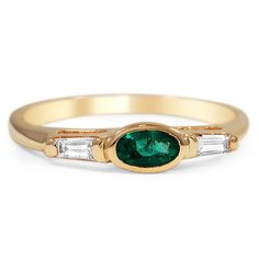 The Sanibel Ring from Brilliant Earth #1960svintagejewelry Specs: .27 ct natural emerald, vivid yellowish green color, moderately included, set in 14 KT yellow gold with 2 tapered baguette diamond accents, G/H color, VS1/VS2 clarity, approx. .14 ct tw