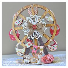 Thienly created this Vintage Carnival Ferris Wheel!  It is amazing!!  Head on over to SVGCUTS and pick up the following to make this wonderful project:  SEPTEMBER AFTERNOON COLLECTION, SUNNY WEEKEND PURSES KIT, DOILIES COLLECTION, EVERYDAY CARDS KIT, PARTY ON ELM STREET KIT, AND HAPPY BIRTHDAY KIT