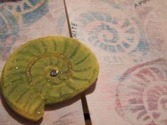 Detail - watercolour background. Handmade ammonite stamp.