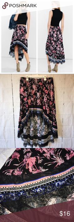 """Express lace trim floral skirt L Black w/floral print. Elastic waist. Side pockets. Hi low hem. Sheer & lace details @ hem. Lightweight.  Like new condition.  Down center front: about 19"""" Down center back: about 35 1/2"""" *Both lengths include lace*  Across waist: about 15 1/2"""" not stretched Express Skirts Asymmetrical"""