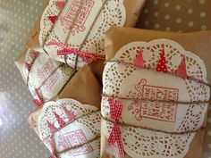 Christmas present wrapping with bunting & paper doilies!