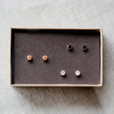 tiny gold stud earrings by elephantine