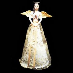 31cm tall Angel which will look serene gracing the top of your tree.