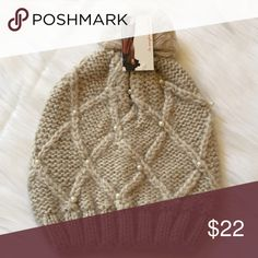 """Pom Pom Beanie This is a NWT Pom Pom Beanie with pearl accents. It's a light beige color. Material is 100% acrylic. Perfect for the colder months!⚜Please see my """"reasonable offers"""" listing at the top of my page before submitting an offer⚜Thank you😊 Do Everything In Love Accessories Hats"""