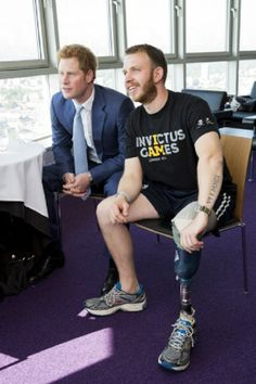 HRH Prince Harry (R) joins former soldier Daniel Whittingham (L) in a live Twitter Q&A session at the top of the BT Tower to answer questions about the Invictus Games following the launch of the tickets going on sale on 15.05.2014 in London, England.