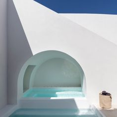 The underground caves of an old house in Fira were converted into a duo of holiday homes by the architecture studio. Santorini House, Fira Santorini, Santorini Island, Underground Pool, Cave Pool, White Building, Ground Floor Plan, Holiday Apartments, Mediterranean Style