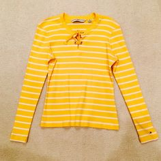 Tommy Hilfiger Striped Long Sleeve Tommy Hilfiger - long sleeved lightweight sweater. Bright, deep yellow with white stripes. Great for spring and summer! Cute detail with a tie in the front scoop neck. Size medium. Looks Brand new! Tommy Hilfiger Sweaters Crew & Scoop Necks
