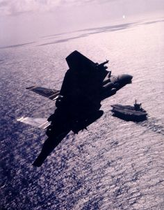 F-14 over the U.S.S. John F. Kennedy.