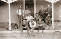 1882 W.S. Ranch cowboys on the porch of their bunkhouse.