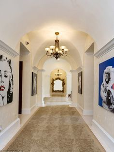 Fine art: Portraits - including one of Marilyn Monroe - line one of the hallways inside th...