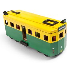This Melbourne Make Me Iconic Tram is painted with authentic colours of yellow, green and black. And based on the iconic W-class Melbourne tram. With 12 passengers and 2 tram conductors this enhances creative play. Melbourne Tram, Melbourne Australia, Ikea Toys, Play Vehicles, Wooden Pegs, Wooden Crafts, All Kids, Wood Toys, Pretend Play