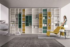 Fabulous set of shelves in mustard, white and sea green.